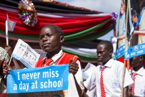 Launch of the Back to Learning campaign in Western Equatoria State. The campaign, an initiative of the Ministry of Science, Education, and Technology, along with partners including UNICEF, aims to get 400,000 children back into classrooms in South Sudan. Students from Yambio County march in school groups in front of the ceremony's invited guests.